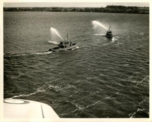 Two TANAC tugs photographed from a Royal Canadian Air Force plane while conducting their acceptance trails in the Bay of Quinte. Photo courtesy, Quinte West Public Library.