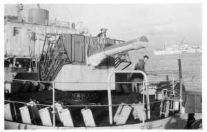 MAYFLOWER's mascot stands on the 4 inch gun barrel.  The Loch class frigate HMCS LOCH ACHANALT is in the background.   Roger Litwiller Collection, courtesy Ralph O'Brien, RCNVR.