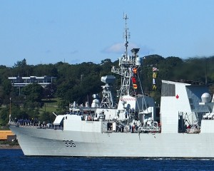 HMCS MONTREAL with the Red Maple Leaf on her funnel returns to Halifax harbour on 28 July 2015. Roger Litwiller Collection, courtesy Roger Litwiller. ( RTL83167)