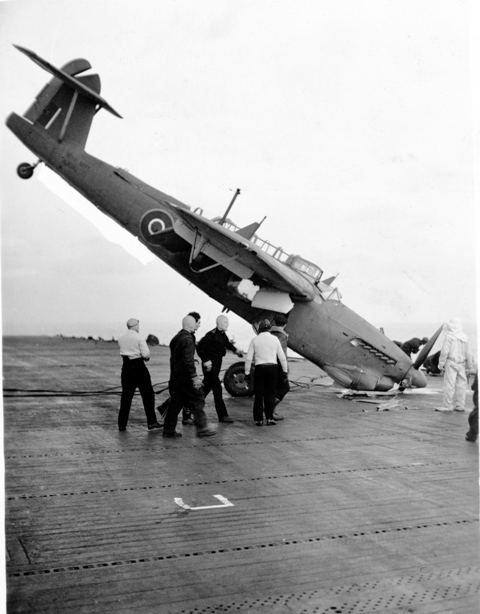 A Barracuda nosed into HMS PUNCHER's flight deck, the rear gunner was slightly injured according to Howard Abbott, the angle of the plane made rescue difficult.  Roger Litwiller Collection, courtesy Howard Abbott, RCNVR. (RTL-HA042)