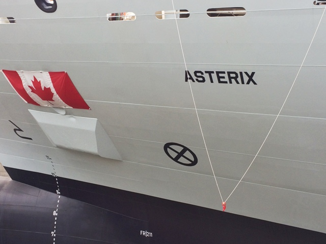 Painted in bold black letters, Asterix's name stands out on the ship side grey hull.  Roger Litwiller Collection, courtesy Roger Litwiller. (IMG_3014)