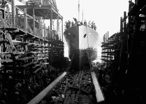 "View of the frigate the H.M.C.S. Toronto sliding down the ways into the water at her launch ceremony on ""Ships for Victory"" day. National Film Board of Canada."