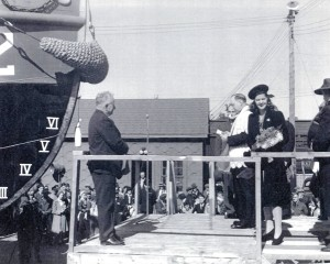 TANAC Tug CT-32 is blessed by Rev. J.J. O'Neil prior to christening by her sponsor Miss Phyllis Craigmyle on 20 September 1943 as part of the SHips For Victory program. Famous Canadian shipbuilder (left) has spearheaded the construction of the Tugs for Central Bridge in Trenton. Photo courtesy Trent Port Historical Society.