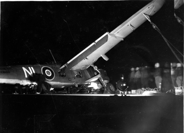 Crashed Barracuda is secured to HMS PUNCHER's deck following a crash, Howard Abbott recalls this plane was later pushed over the side.  Roger Litwiller Collection, courtesy Howard Abbott, RCNVR. (RTL-HA043)