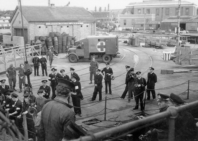 Landing Wounded Sailors