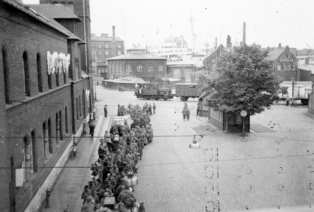 A large group of German Prisoners-of-War in Copenhagen, Denmark in May 1945. Photo taken by Lynford Boune while his ship HMCS IROQUOIS was in the city following the surrender of German forces. Roger Litwiller Collection, Lynford Bourne, RCNVR photo, courtesy Battle of Atlantic Place. (RTL-LRB031)