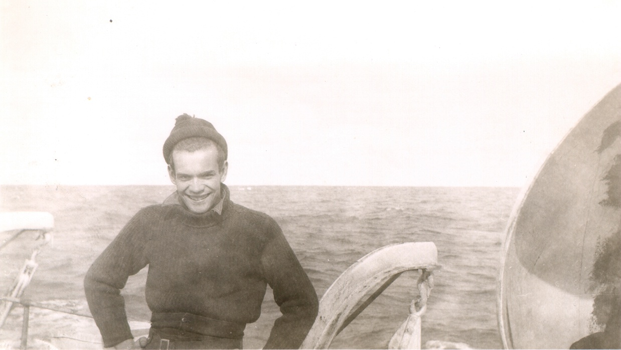 An unidentified RCN sailor in HMCS TRENTONIAN while the corvette is crossing the Atlantic Ocean to join the invasion in April 1944.  He is standing above the port side depth charge throwers. Roger Litwiller Collection, courtesy of Jack Harold, RCNVR. (RTL-JH069)