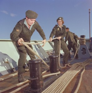 MS Pierre Gendron and Cpl. S. Thompson, Supply Tech, HMCS Cormorant. MS Gendron makes a turn on the bollards while Cpl. Thompson handles the slack line. Photo Courtesy RCN DHist.