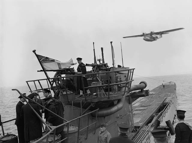 Surrender of the German submarine U-889. The aircraft is a Consolidated Canso A flying boat of No. 161 Squadron, R.C.A.F. Credit: Canada. Dept. of National Defence / Library and Archives Canada / PA-116720.