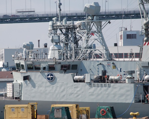 HMCS CHARLOTTETOWN has her NATO shield on the bridge, as the frigate is readied for her six month deployment on 4 August 2017. Roger Litwiller Collection, courtesy Roger Litwiller. (RTL44719)